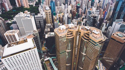 Fotomurales - Top view aerial photo from flying drone of a business center in China with headquarter and office buildings with contemporary architecture. Exterior of a skyscrapers in metropolitan Hong Kong city