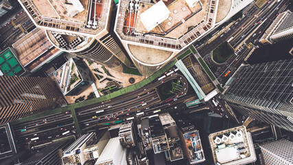 Fotomurales - Top view aerial photo from flying drone of a tall skyscrapers with contemporary design, road with cars. Developed China city with commercial and financial centers. Buildings roofs in business district