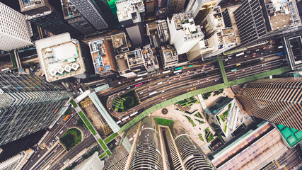 Fotomurales - Top view aerial photo from flying drone of a developed Hong Kong city with modern skyscrapers with contemporary design. China town with business and financial centers and road with cars