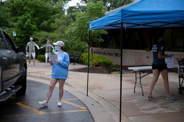 Children go through COVID-19 checks before summer camp