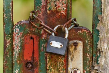 Metal gate locked by a padlock and chain