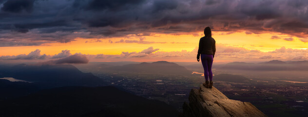 Fantasy Adventure Composite with a Girl on top of a Rock Cliff with Beautiful Nature in Background...