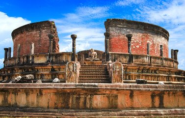 Sri Lanka travel and landmarks - ancient city of Polonnaruwa, UNESCO World Heritage Site. Buddha statue in Vatadage temple
