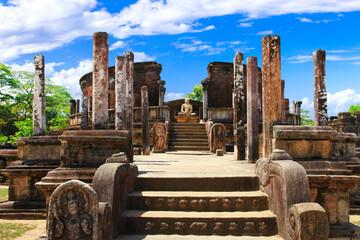 Sri Lanka travel and landmarks - ancient city of Polonnaruwa, UNESCO World Heritage Site. Buddha statue in Vatadage temple