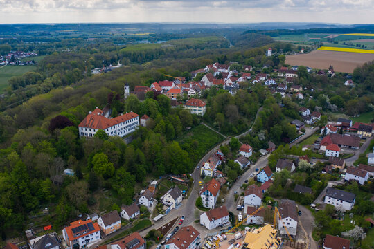 Aerial view of the village Oberkirchberg, Illerkirchberg in Germany, Bavaria on a sunny spring day during the coronavirus lockdown.