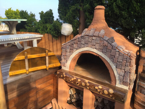 DIY Pizza Oven, a series of images showing how to build your own wood-burning outdoor oven in a garden next to the Pacific Ocean In Chiba Japan.