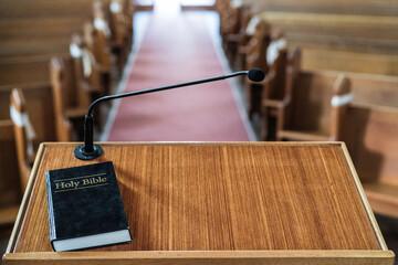 Obraz Bible on church pulpit in empty church - fototapety do salonu