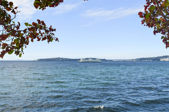 View of Puget Sound with a ferry on the water that runs from Seattle to other destinations in the Pacific Northwest.