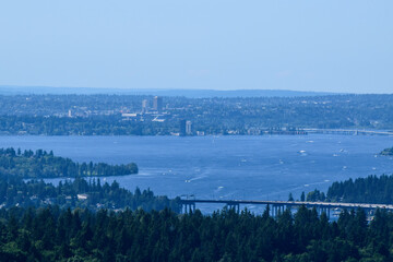 View over Lake Washington towards East Seattle; highway bridges I-90 and 520 across the lake can be partially seen in the photo.