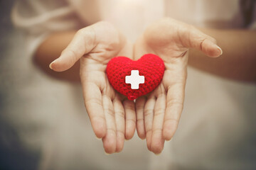 Hand giving red heart for help blood donation healthcare together share love to fight disease...