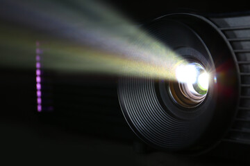 Glowing modern video projector, closeup