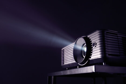 Modern video projector on dark background