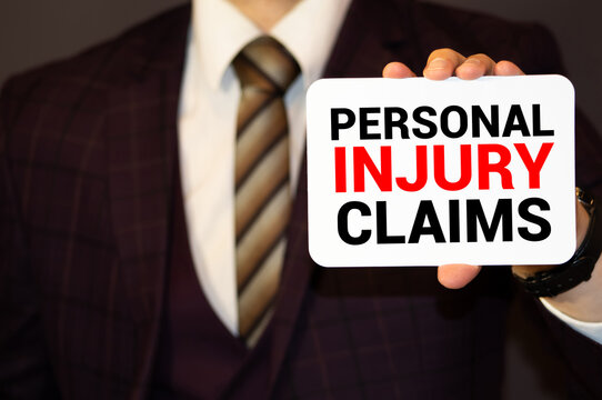 A man holding a Business card Insurance Claim Concept