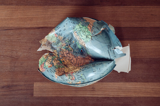 a shattered globe as a metaphor for the problems of mankind and the approaching collapse of our planet earth