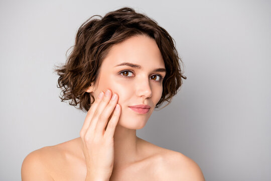 Portrait of lovely pretty charming girl have skin care plastic surgery procedure look in mirror touch finger hands face isolated over gray color background