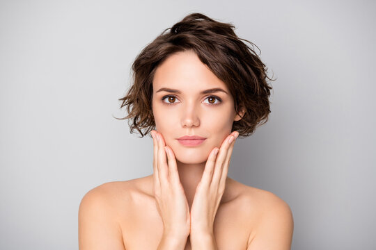 Closeup photo of beautiful nude lady short bob hairdo rejuvenation spa salon procedure soft facial skin touch arms cheekbones aesthetic look isolated grey color background