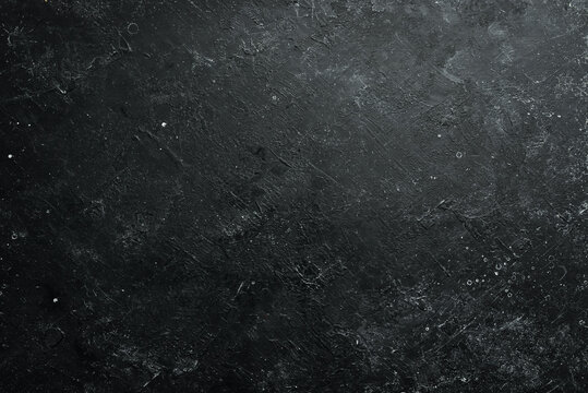 Black stone background. Free space for your text. Top view. Rustic style.