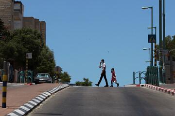 Israel, Palestinians tighten restrictions as coronavirus reemerges