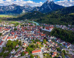 Aerial view of the old town of the city Füssen in Bavaria on a sunny day in spring during the coronavirus lockdown.