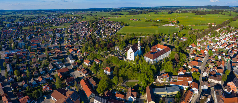 Aerial view of the city and monastery Marktoberdorf in Germany, Bavaria on a sunny spring day during the coronavirus lockdown.