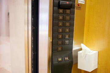 A napkin box is seen next to the buttons in a hotel's elevator following the coronavirus disease (COVID-19) outbreak, in Shanghai