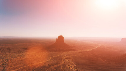 Fototapeten Ziegel Bird's eye scenery view of unique geological formation of Arizona landmark. Monument Valley rocks one of the National symbols of the United States of America. Sandy desert landscape with roads