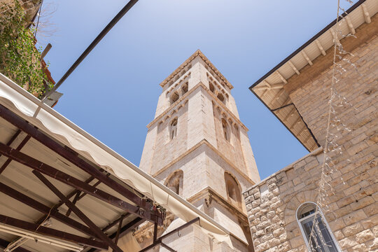 The bell tower of Lutheran Church of the Redeemer rises above the ranks of the Arab Bazaar in the old city of Jerusalem, Israel