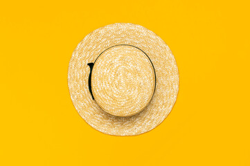 Women s summer straw hat on yellow background top view flat lay copy space. Summer travel vacation concept, single item. Female accessory, summer background. Sea sun vacation beach