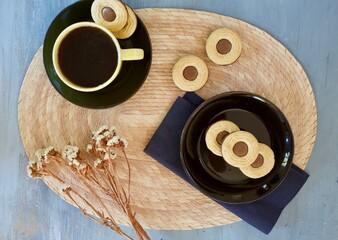 Cute flat lay of Swedish ballerina cookies and coffee