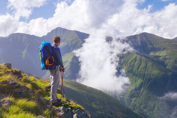 Hiker looks at the beautiful Romanian Carpathians, Fagerash array