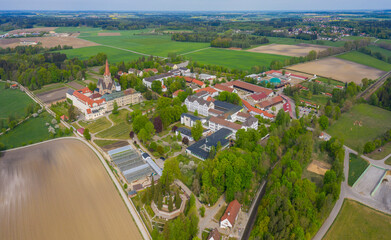 Aerial view of the monastery St. Ottilien close to Eresing in Germany, Bavaria on a sunny spring day during the coronavirus lockdown.