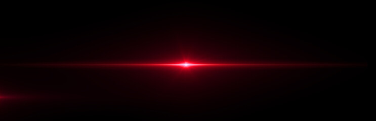 Red lens flare light on black background