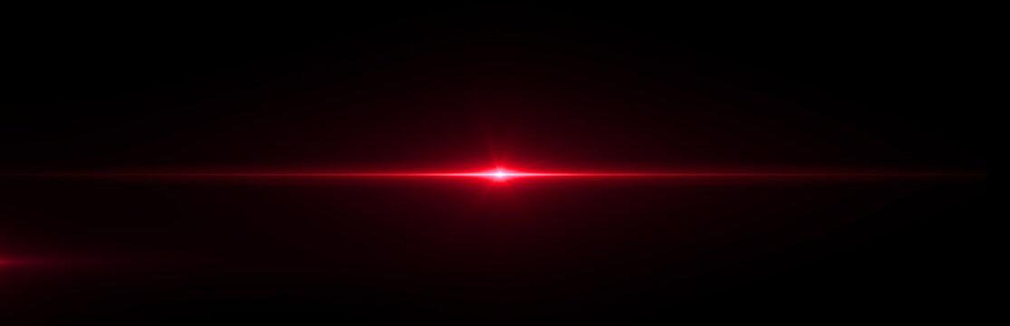 Red lens flare light on black background