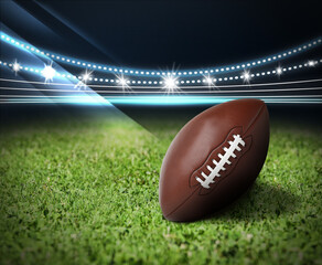 Leather American ball on green football field