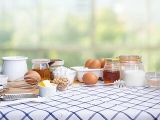 Selective focus.Cooking breakfast food or bakery with ingredient and copy space of tablecloth on blur green bokeh