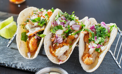 mexican fish tacos in metal tray