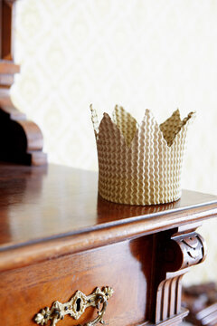 Cardboard crown on chest of drawers