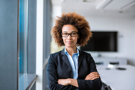 Portrait of confident young businesswoman in conference room