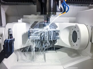 Fototapeta New high performance 5 axis CNC machining centre. Milling process with emulsion.