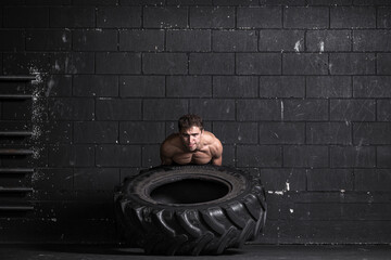 Athlete exercising with tractor tire