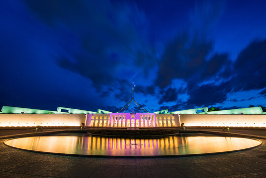 Pool of reflection at night in front of Parliament House Canberra