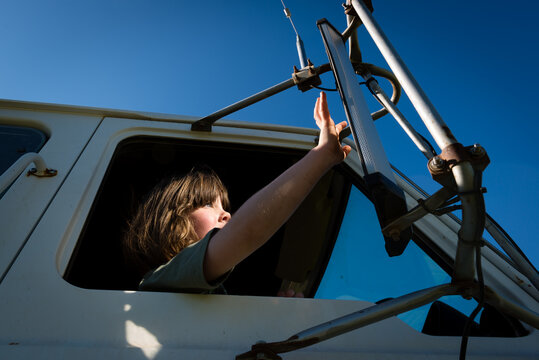 Low angle view of girl sitting in truck