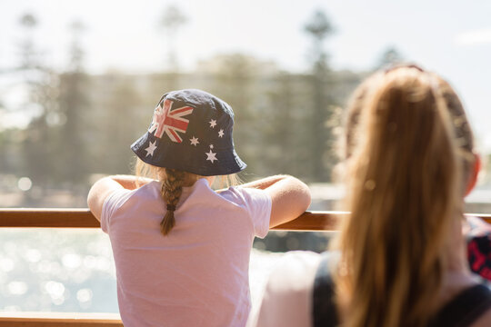 young girl on ferry to Manly, wearing an Aussie flag sun hat