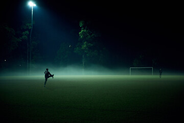 Game in play on football field in fog
