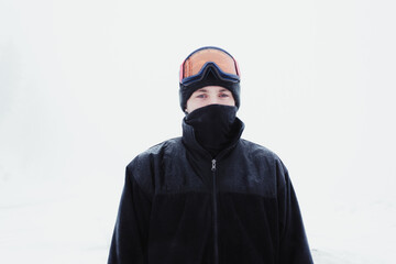Young man bundled in ski wear
