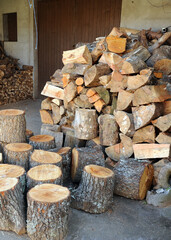 Pine firewood stored for the winter. Warehouse and woodshed in a house in Laza, village in the province of Ourense, Galicia, Spain
