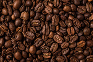 Tuinposter koffiebar Roasted coffee beans on the table, macro