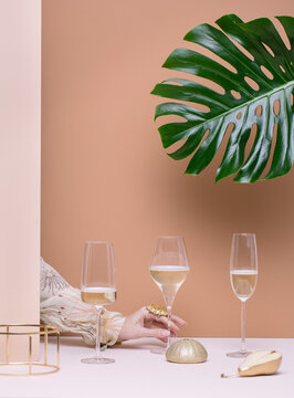 Crop elegant hand choosing wineglass from composition