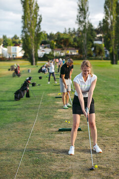 Middle age woman at golf driving range