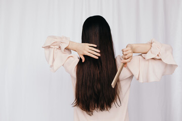 Anonymous woman combing hair